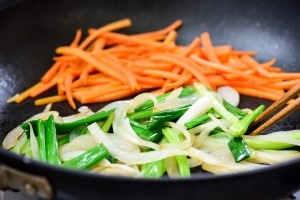 Stir-fry carrot, onion, and scallions for japchae