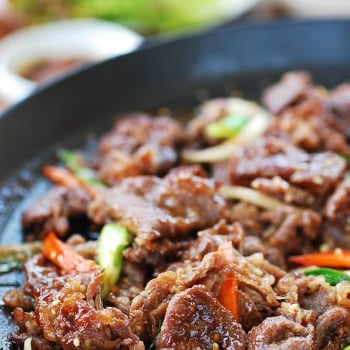 Char grilled Korean BBQ beef in a grill pan