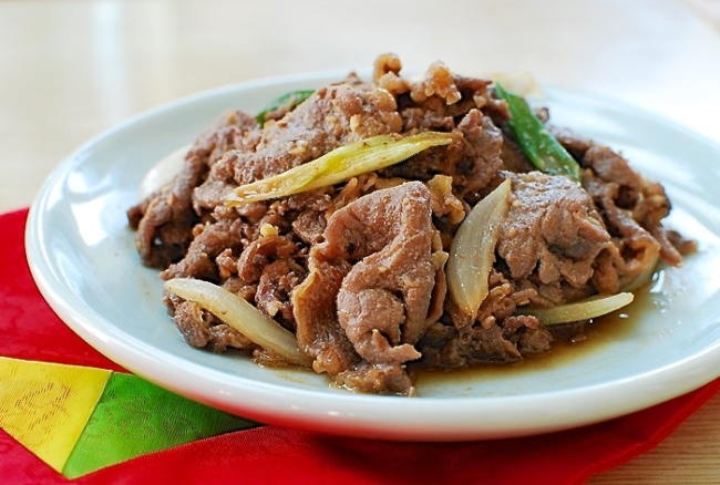 Korean BBQ Beef (bulgogi) served on a small white plate