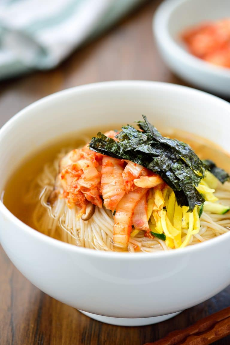 Warm noodle soup with thin wheat noodles and kimchi
