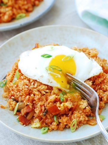 Kimchi fried rice in a large plate with a sunny side up egg
