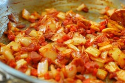 Stir-frying kimchi with bacon