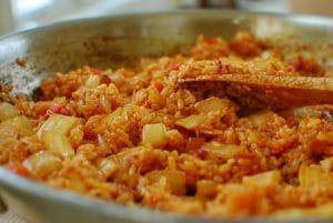 stir frying kimchi and rice