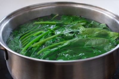 blanching spinach in a pot