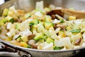 Stir-frying pork and vegetables for Korean black bean noodles