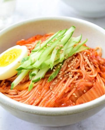 red spicy noodles with Kimchi, cucumbers and egg
