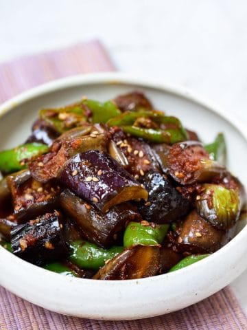 Cubed eggplants with sliced green peppers stir-fried in a gochujang sauce