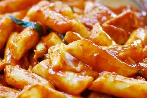 Korean rice cakes in a red spicy gochujang sauce