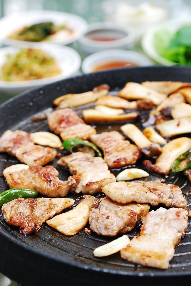 Serve with red or green leaf lettuce, in which to wrap the meat, along with ssamjang.   .