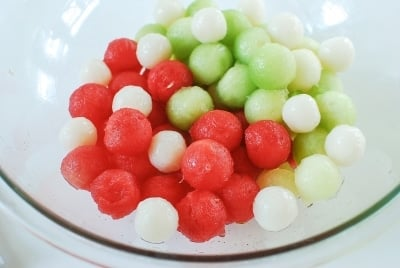 Watermelon and honeydew balls for punch in a glass bowl