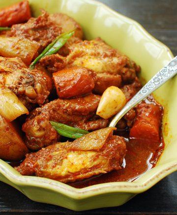 Red spicy braised Korean chicken in a casserole dish