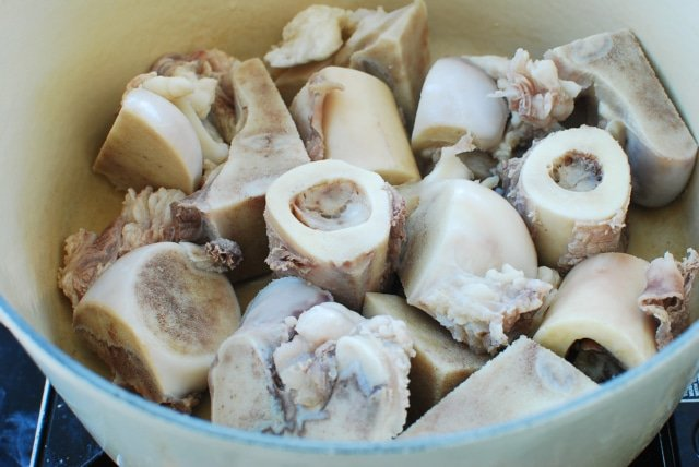 parboiled beef bones in a pot