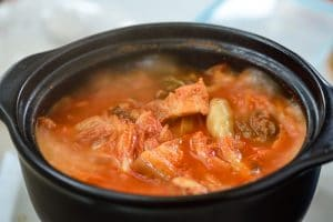 boiling kimchi stew in an earthen pot