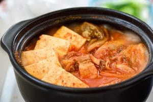 Kimchi stew with tofu in an earthenware