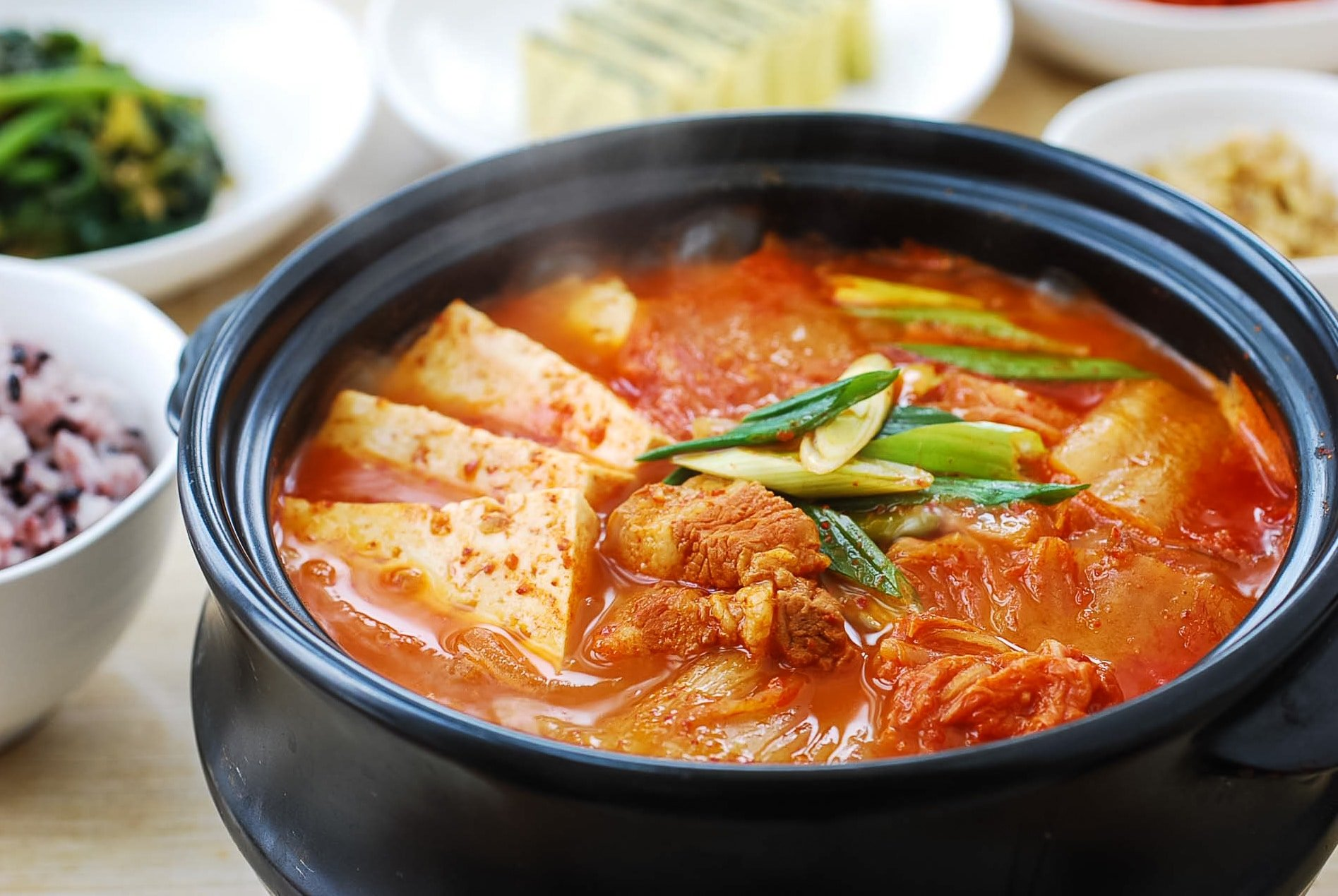Red spicy kimchi stew in an earthen pot