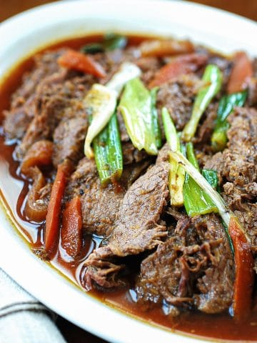 Slow cooker Korean beef bulgogi served in a large plate