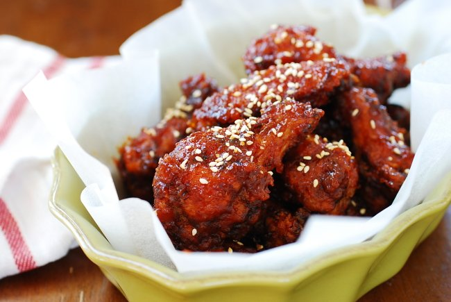 Korean fried chicken smothered in a red spicy sauce