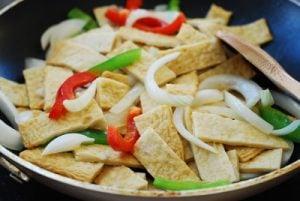 stir frying Korean fish cake and vegetables in a pan