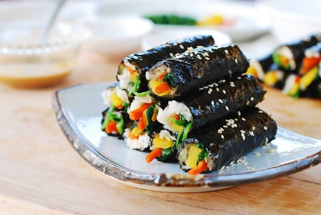 a pile of mini kimbap on a plate