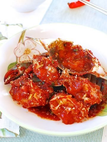 Red spicy marinated raw blue crabs