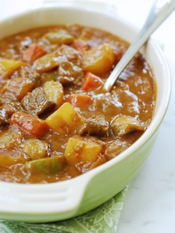 Korean curry rice with beef and vegetables in a casserole dish