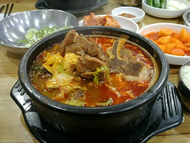 Boiling hot Haejangguk (hangover soup) in an earthen ware at a restaurant in Seoul