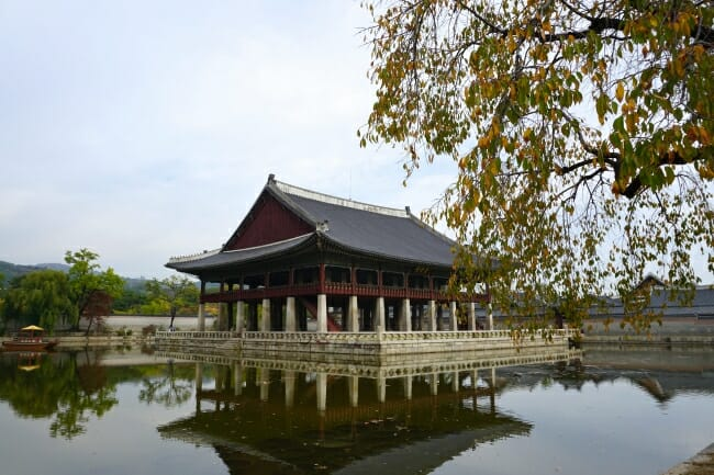 beautiful pond and a traditional building at Gyeongbokgung Palace