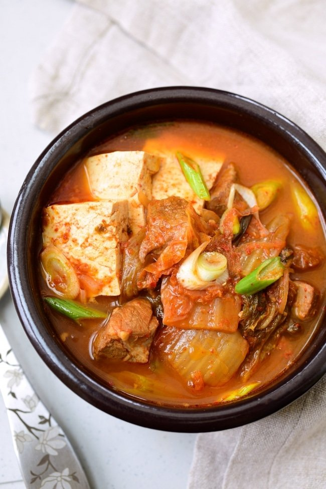 Spicy Kimchi Stew served in an earthen ware