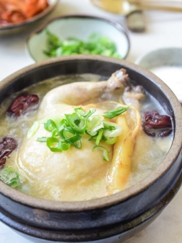 a small whole chicken soup in an earthenware with ginseng