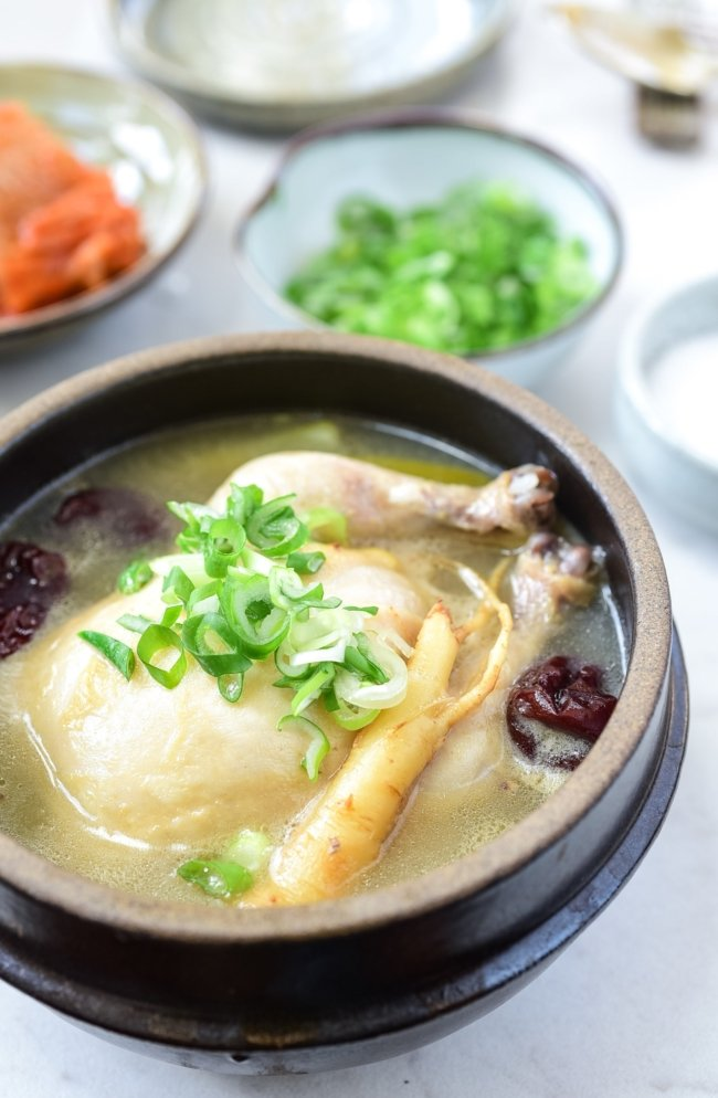 Korean cornish hen soup with ginseng in a pot