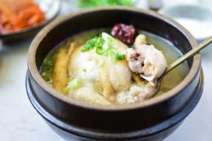 A small whole chicken soup with ginseng and rice