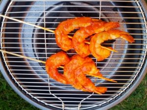 Red spicy shrimp on a grill