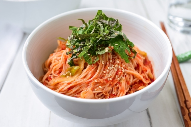 Red spicy cold noodle dish with kimchi