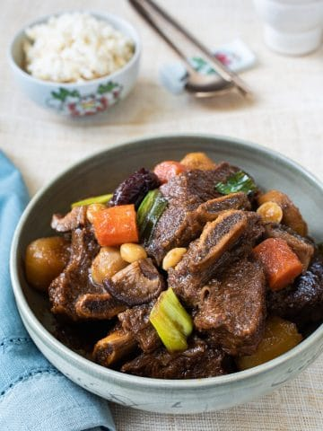 Korean braised beef short ribs served with a bowl of rice