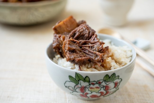 Korean braised beef short ribs over rice