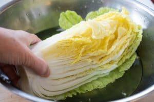 salting napa cabbage quarter in salt water