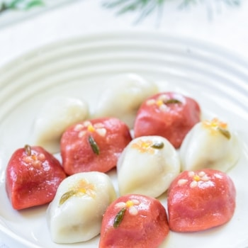 Korean half moon shape rice cakes in two colors - white and red