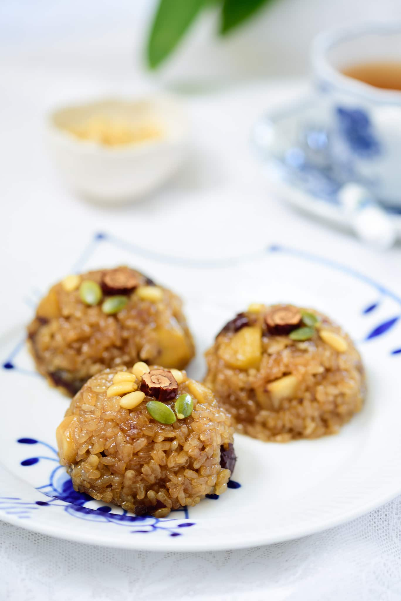 Korean sweet rice deThree round shaped Korean sweet rice dessert in a plate