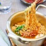 Korean ramen made with soft tofu served with kimchi