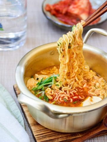 Korean ramen made with soft tofu served with kimchi