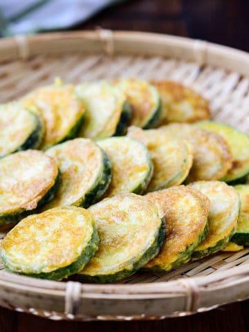 Korean zucchini fritter in a shallow bamboo basket